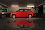Red Suzuki Swift Sport reflection