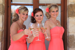 Bridesmaids holding champagne flutes